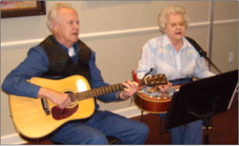 Man and Woman Playing Guitar and Dobro
