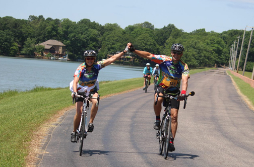 Two Bikers Raising Clasped Hands