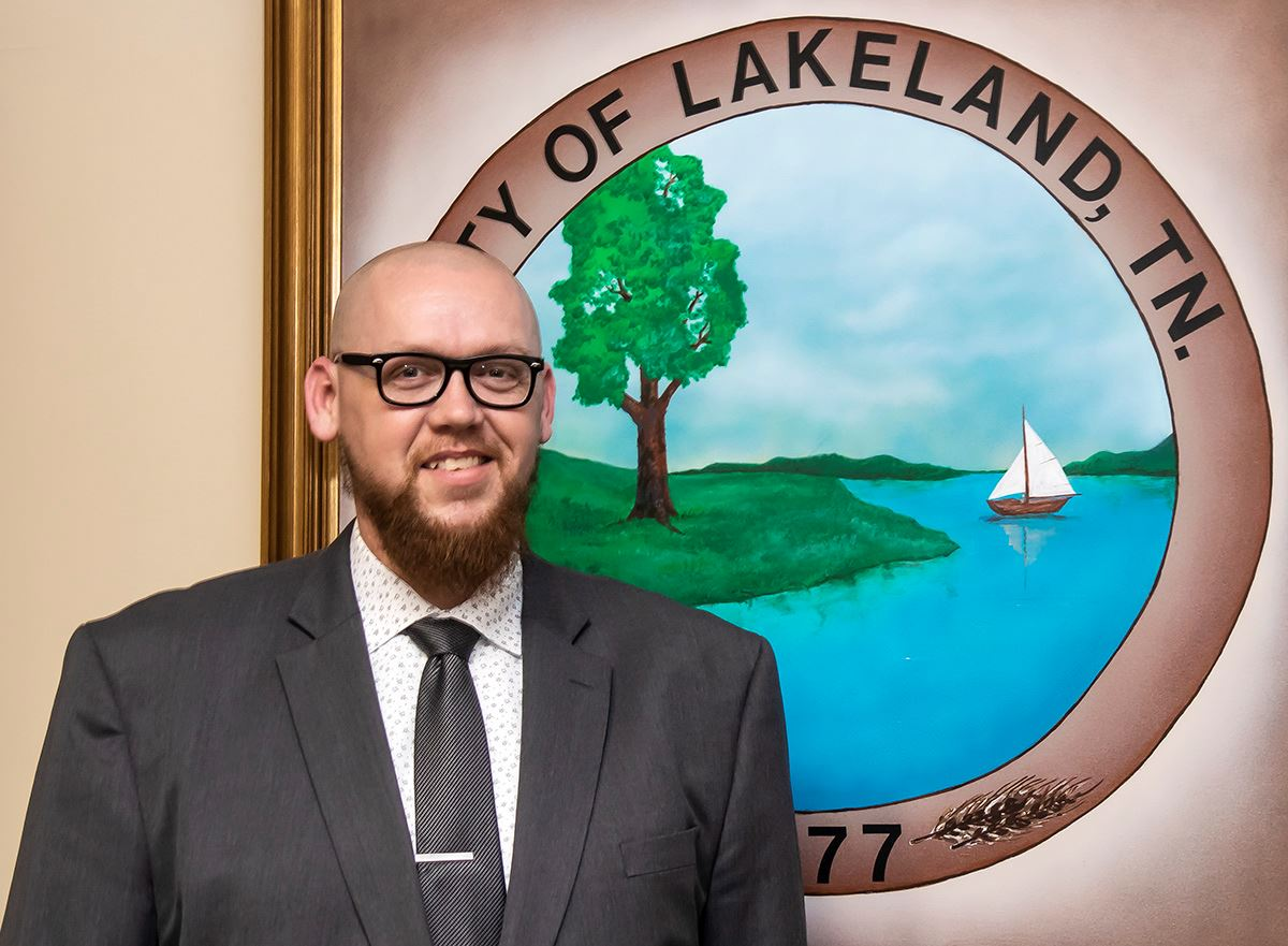 Photograph of Michael Walker in front of City Seal